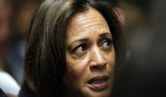 FILE - In this Oct. 22, 2018, file photo, Sen. Kamala Harris, D-Calif., speaks to reporters following a get out the vote rally at Des Moines Area Community College in Ankeny, Iowa. As she nears a decision on whether to seek the presidency, Harris is striking a delicate balance on what could be a hurdle in a Democratic primary: her past as a prosecutor.  (AP Photo/Charlie Neibergall, File)