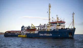 The Sea-Watch rescue ship waits off the coast of Malta, Tuesday, Jan. 8, 2018. Two German nonprofit groups are appealing to European Union countries to take in 49 migrants whose health is deteriorating while they are stuck on rescue ships in the Mediterranean Sea. Sea-Watch and Sea-Eye representatives told reporters in Berlin on Tuesday that drinking water was being rationed on their ships and some migrants had trouble eating due to illness.  (AP Photo/Rene Rossignaud)
