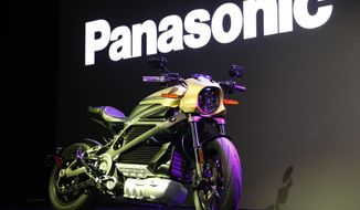 A Harley-Davidson Motorcycles LiveWire electric motorcycle is on display during a Panasonic news conference at CES International, Monday, Jan. 7, 2019, in Las Vegas. (AP Photo/John Locher)