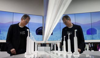 Hansjoerg Reick looks at a display of Oral-B Genius X smart toothbrushes at the Procter & Gamble booth before CES International, Monday, Jan. 7, 2019, in Las Vegas. (AP Photo/John Locher)
