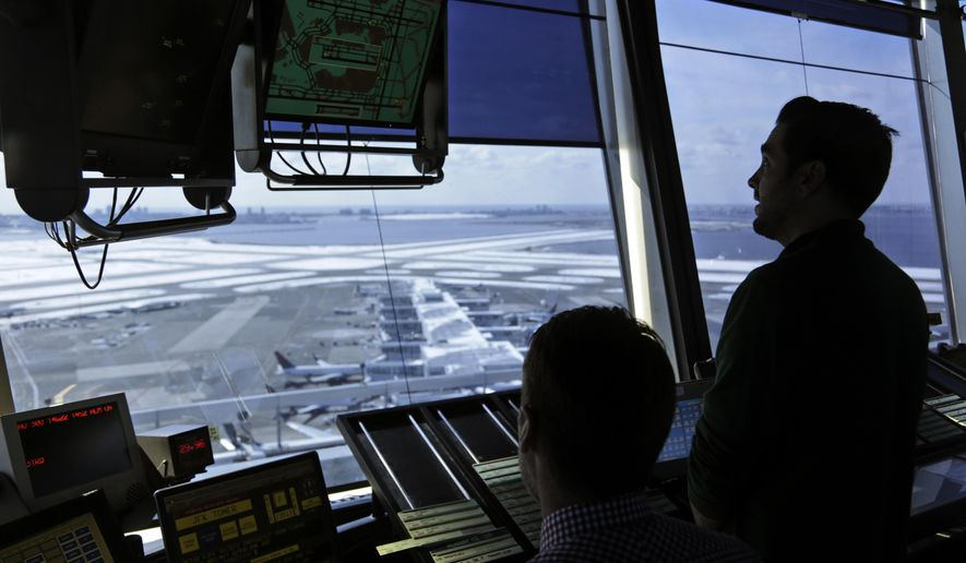 In this March 16, 2017, file photo, air traffic controllers work in the tower at John F. Kennedy International Airport in New York. The partial government shutdown is starting to affect air travelers. Over the weekend, some airports had long lines at checkpoints, apparently caused by a rising number of security officers calling in sick while they are not getting paid. (AP Photo/Seth Wenig, File)