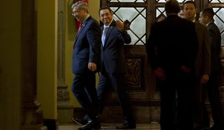 Guatemala's President Jimmy Morales, center back, and Vice President Jafeth Cabrera walk after a statement at the National Palace in Guatemala City, Monday, Jan. 7, 2019. Guatemala announced that it is going to withdraw from UN-sponsored anti-corruption commission. (AP Photo/Moises Castillo)