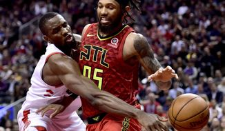 Toronto Raptors forward Serge Ibaka (9) knocks the ball from Atlanta Hawks forward DeAndre Bembry (95) during the second half of an NBA basketball game Tuesday, Jan. 8, 2019, in Toronto. (Frank Gunn/The Canadian Press via AP)