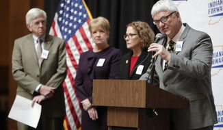 State Rep. Tony Cook, R-Cicero, is joined by state Reps. Ed DeLaney, D-Indianapolis, left, Cindy Ziemke, R-Batesville, center left, and Donna Schaibley, R-Carmel, center right, as they at discuss hate crimes legislation at the Statehouse in Indianapolis, Tuesday, Jan. 8, 2019. Indiana remains one of just five states without a clear and specific hate crimes law. (AP Photo/Michael Conroy)