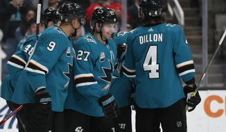 San Jose Sharks' Evander Kane (9) celebrates with Joonas Donskoi (27) who scored goal against the Los Angeles Kings in the first period of an NHL hockey game in San Jose, Calif., Monday, Jan. 7, 2019. (AP Photo/Josie Lepe)
