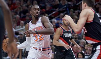 New York Knicks forward Noah Vonleh, left, drives to the basket in front of Portland Trail Blazers forward Zach Collins during the first half of an NBA basketball game in Portland, Ore., Monday, Jan. 7, 2019. (AP Photo/Craig Mitchelldyer)