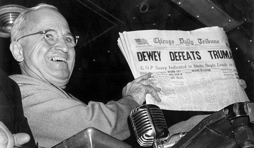 "FILE - In this Nov. 4, 1948, file photo, President Harry S. Truman at St. Louis' Union Station holds up an election day edition of the Chicago Daily Tribune, which - based on early results - mistakenly announced ""Dewey Defeats Truman."" (AP Photo/Byron Rollins)"