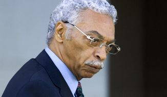 FILE - In this Oct 19, 2009, file photo, Birmingham Mayor Larry Langford stares at the media while leaving for lunch during jury selection outside the Federal Building in Tuscaloosa, Ala. Former Birmingham Mayor Langford has died a week after being released from prison because of his failing health. Birmingham Mayor Randall Woodfin announced Langford's passing Tuesday evening, Jan. 8, 2019. He was 72. (AP Photo/Butch Dill, File)