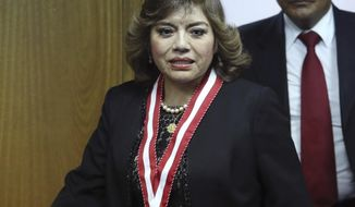 Newly appointed Attorney General Zoraida Avalos arrives for a press conference on the day she was appointed the position in Lima, Peru, Tuesday, Jan. 8, 2019. The former attorney general, Pedro Chavarry, resigned earlier in the day amid accusations he hindered a corruption probe involving Brazilian construction giant Odebrecht. (AP Photo/Martin Mejia)