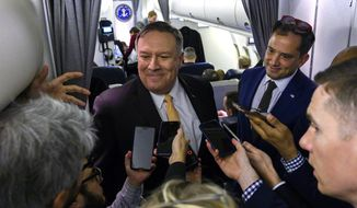 U.S. Secretary of State Mike Pompeo talks to reporters on his plane on his way to the Middle East, Monday, Jan. 7, 2019. (Andrew Caballero-Reynolds/Pool via AP)