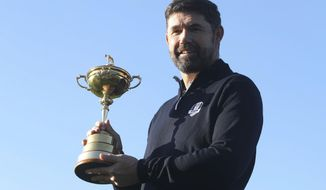 Padraig Harrington holds the Ryder Cup for the media at the Wentworth Golf Club, south England, Tuesday Jan. 8, 2019. Padraig Harrington has been chosen as captain of the Europe team for the 2020 Ryder Cup at Whistling Straits, it was announced by the European Tour at its headquarters at Wentworth. (Adam Davy/PA via AP)