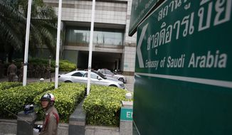 A policeman patrols outside the Saudi embassy in Bangkok Tuesday, Jan. 8, 2019. Thailand's Immigration Police chief met Tuesday with officials of the Saudi Embassy in Bangkok and said the officials told him they are satisfied with how the case of the young Saudi woman who claims to be fleeing her abusive family has been settled. (AP Photo/Sakchai Lalit)