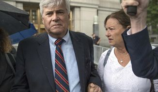 FILE - In this July 17, 2018, file photo, former Republican New York state Senate leader Dean Skelos and his wife, Gail, right, leave federal court in New York after he and his son Adam were convicted on charges of extortion, wire fraud and bribery. On Tuesday Jan. 8, 2019, the elder Skelos is expected to report to the federal prison at Otisville, New York, to begin serving his prison sentence, while his son will report to the federal prison in Danbury, Connecticut, to begin serving his sentence. (AP Photo/Mary Altaffer, File)