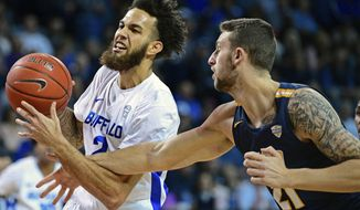 Buffalo guard Jeremy Harris is fouled by Toledo guard Dylan Alderson during the first half of an NCAA college basketball game, Tuesday, Jan. 8, 2019, in Amherst, New York. (AP Photo/David Dermer)