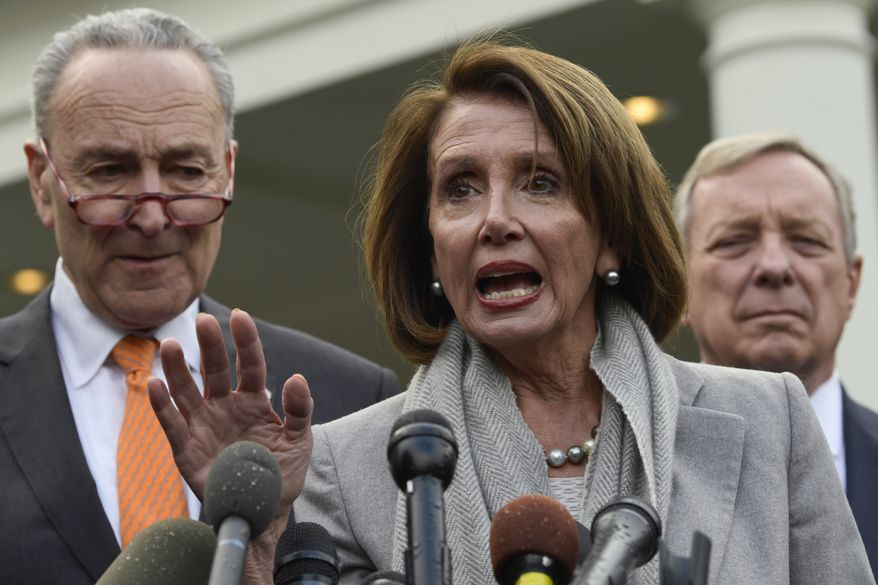 House Speaker Nancy Pelosi of Calif., center, speaks as she stands next to Senate Minority Leader Sen. Chuck Schumer of N.Y., left, and Sen. Dick Durbin, D-Ill., right, following their meeting with President Donald Trump at the White House in Washington, Wednesday, Jan. 9, 2019. (AP Photo/Susan Walsh) ** FILE **