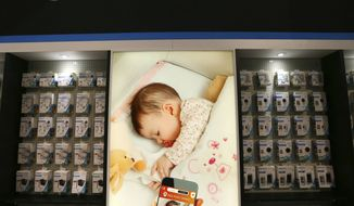 Vivitar Smart Home products include a baby monitor and phone app as part of their safety products at CES International Wednesday, Jan. 9, 2019, in Las Vegas. (AP Photo/Ross D. Franklin)