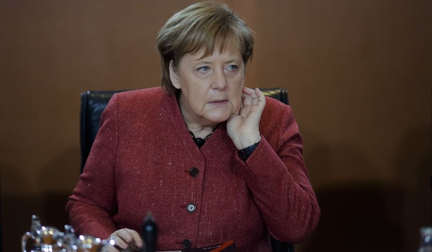 German Chancellor Angela Merkel attends the weekly cabinet meeting of the German government at the chancellery in Berlin, Germany, Wednesday, Jan. 9, 2019. (AP Photo/Markus Schreiber)
