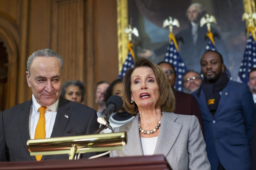 Speaker of the House Nancy Pelosi, D-Calif., and Senate Minority Leader Chuck Schumer, D-N.Y., left, are joined by furloughed federal workers at an event to discuss the impact on families from the partial government shutdown amid President Donald Trump's demands for funding a U.S.-Mexico border wall, on Capitol Hill in Washington, Wednesday, Jan. 9, 2019. (AP Photo/J. Scott Applewhite)
