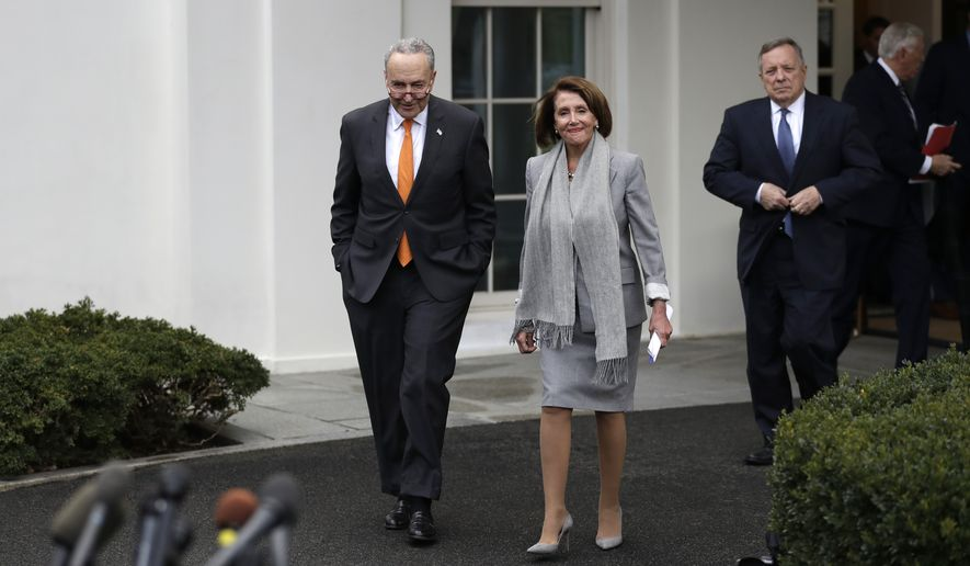 From left, Senate Minority Leader Chuck Schumer of N.Y., House Speaker Nancy Pelosi of Calif., and Sen. Dick Durbin, D-Ill., arrive to speak with reporters after a meeting with President Donald Trump in the Situation Room of the White House, Wednesday, Jan. 9, 2018, in Washington, about border security. (AP Photo/ Evan Vucci)