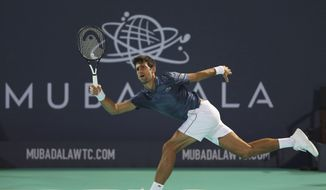 Serbia's Novak Djokovic returns the ball to South Africa's Kevin Anderson during the final match of the Mubadala World Tennis Championship in Abu Dhabi, United Arab Emirates, Saturday, Dec. 29, 2018. (AP Photo/Kamran Jebreili)