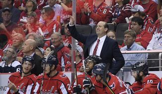 FILE - In this Oct. 3, 2018, file photo, Washington Capitals head coach Todd Reirden gestures from the bench during the first period of an NHL hockey game against the Boston Bruins, in Washington. Reirden and Calgary Flames coach Bill Peters will coach the NHL All-Star Game Jan. 26 after leading their respective divisions at the halfway mark. (AP Photo/Nick Wass, File) **FILE**