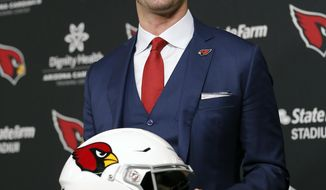 The Arizona Cardinals new head coach Kliff Kingsbury poses for photos, Wednesday, Jan. 9, 2019, in Tempe, Ariz. The Arizona Cardinals introduced Kliff Kingsbury as their new coach a day after hiring the former Texas Tech coach in a bid to revitalize the worst offense in the NFL. (AP Photo/Rick Scuteri)