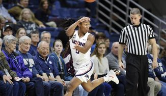 Connecticut's Crystal Dangerfield (5) looks for an outlet after stealing the ball during the first half of the team's NCAA college basketball game against Cincinnati on Wednesday, Jan. 9, 2019, in Storrs, Conn. (AP Photo/Stephen Dunn)