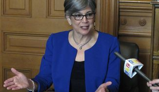"""FILE - In this Oct. 5, 2016 file photo, Kansas Senate President Susan Wagle, R-Wichita, answers questions from reporters during a news conference at the Statehouse in Topeka, Kan. Wagle says she's considering running for the U.S. Senate in 2020 and plans to form an exploratory committee. Wagle told The Wichita Eagle on Wednesday, Jan. 9, 2019, that she is taking a """"serious look"""" at the race. Republican U.S. Sen. Pat Roberts announced Friday, Jan. 4 that he will not seek re-election. Wagle is the latest prominent Republican to express an interest. Wagle is from Wichita and has served in the Legislature since 1993. (AP Photo/John Hanna, File)"""