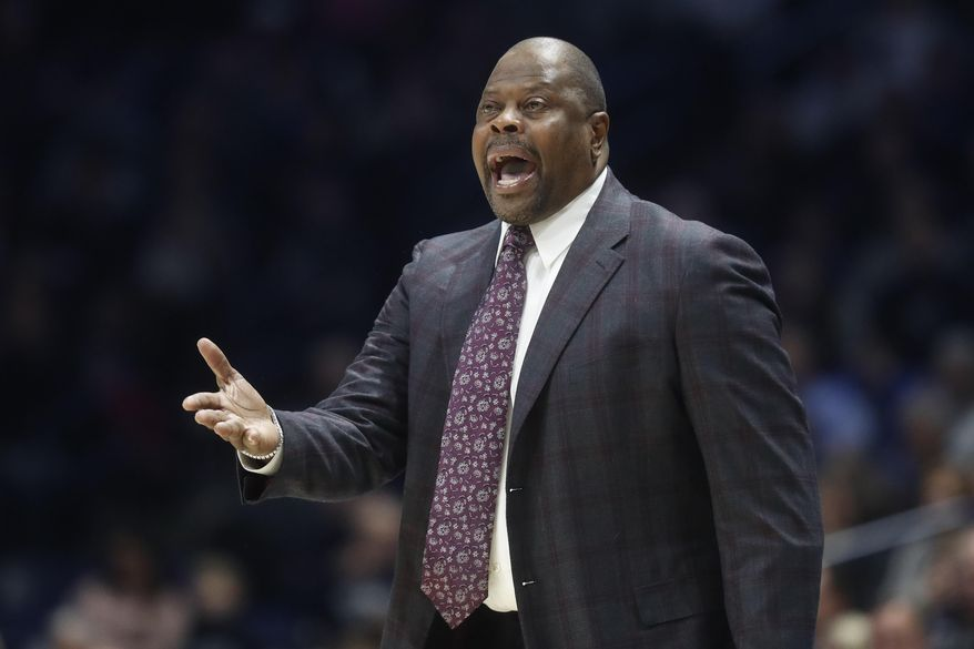 Georgetown head coach Patrick Ewing reacts at the bench during the first half of an NCAA college basketball game against Xavier, Wednesday, Jan. 9, 2019, in Cincinnati. (AP Photo/John Minchillo) ** FILE **