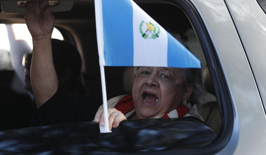 A woman chants slogans against the United Nations International Commission Against Impunity, CICIG, during a rally in Guatemala City, Tuesday, Jan. 8, 2019. A decade-long, U.N.-assisted anti-corruption effort that brought down a president faced extinction after the Guatemalan government ended the agreement, drawing condemnation Tuesday from transparency and rights groups. (AP Photo/Moises Castillo)