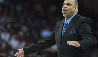 """FILE - In this Nov. 20, 2016, file photo, Hampton coach David Six communicates with players during the first half of the team's NCAA college basketball game against South Carolina in Columbia, S.C. Six has cherished being able to lead the Lady Pirates after suffering a stroke on June 27. The 55-year-old coach, who has guided Hampton to the NCAA Tournament in six of the past eight seasons, was told originally by doctors that he would probably need to take the year off from coaching to recover. He would have none of that. Six months later after intense """"boot-camp rehab"""", the only remnants of the stroke are a torn rotator cuff in his right shoulder he suffered when he fell and a slight limp. He's still doing some rehab to improve his strength, including water aerobics--which he did before suffering the stroke. (AP Photo/Sean Rayford, File)"""