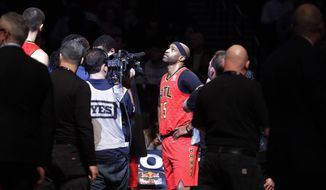 Atlanta Hawks' Vince Carter (15) watches a video tribute to him during the first half of the team's NBA basketball game against the Brooklyn Nets on Wednesday, Jan. 9, 2019, in New York. (AP Photo/Frank Franklin II)