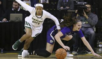 Baylor guard Juicy Landrum, left, reaches for a loose ball with Kansas State guard Rachel Ranke, right, in the first half of an NCAA college basketball game, Wednesday, Jan. 9, 2019, in Waco, Texas. (AP Photo/Rod Aydelotte)