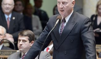 FILE - In this Jan. 8, 2013 file photo, Republican Dan Seum speaks to the Kentucky Senate to nominate Robert Stivers as President of the Kentucky State Senate in Frankfort, Ky.  Seum was one of a bipartisan group of Kentucky lawmakers on Wednesday, Jan. 9, 2019 who introduced a bill that would make marijuana legal in Kentucky for medical purposes only. The proposal comes weeks after the U.S. Congress, led by U.S. Sen. Mitch McConnell, legalized hemp, a crop that comes from the same plant that produces marijuana.   (AP Photo/Timothy D. Easley)