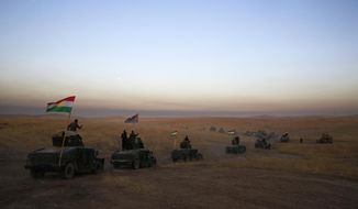 FILE -- In this Oct. 17, 2016 file photo, a Kurdish Peshmerga convoy drives towards a frontline in Khazer, about 30 kilometers (19 miles) east of Mosul, Iraq. Over the past century, Kurds in the Mideast have gotten close to setting up their own state or autonomous regions on several occasions only to have their dreams shattered after being abandoned by world powers. The latest instance comes with Syria's Kurds who with U.S. backing have led the fight against the Islamic State group in that country. Now the U.S. plans to withdraw from Syria, leaving the Kurds to face Turkish forces. (AP Photo/Bram Janssen, File)