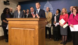 Minnesota House Majority Leader Ryan Winkler and other House Democratic leaders announce on Wednesday, Jan. 9, 2019, in St. Paul., Minn., the first 10 bills they'll introduce in Minnesota's 2019 legislative session. (AP Photo/Steve Karnowski).