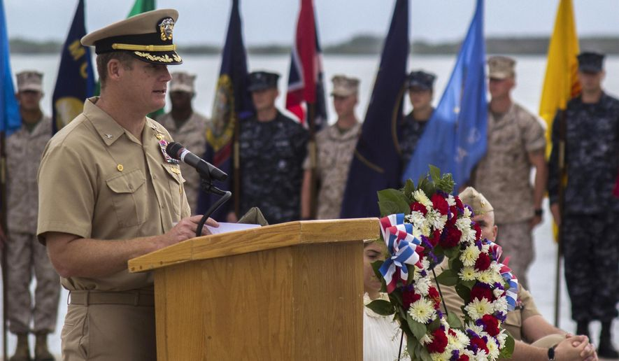 FILE - In this June 3, 2014, image provided by the U.S. Navy, Navy Capt. John R. Nettleton, then-commanding officer of Naval Station Guantanamo Bay, Cuba, speaks during a Battle of Midway commemoration ceremony. Nettleton was arrested Wednesday, Jan. 9, 2018, on charges that he interfered with the investigation into the death of a civilian with whom he fought after an argument over whether the officer had had an affair with the man's wife.(Mass Communication Specialist 3rd Class Jacob Goff/U.S. Navy via AP)