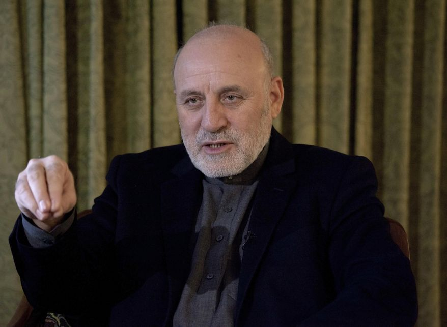 Afghan president's special peace envoy Mohammad Omer Daudzai speaks during an interview with The Associated Press in Islamabad, Pakistan, Wednesday, Jan. 9, 2019.  Daudzai expressed hope Tuesday that the war that has ravaged Afghanistan for over 17-years and cost the United States an estimated one trillion dollars will end in 2019. (AP Photo/Anjum Naveed)