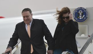 Secretary of State Mike Pompeo and his wife Susan disembark from their aircraft as they arrive in Amman, Jordan at the start of a Middle East tour, Tuesday, Jan. 8, 2019.  (Andrew Caballero-Reynolds/Pool Photo via AP)