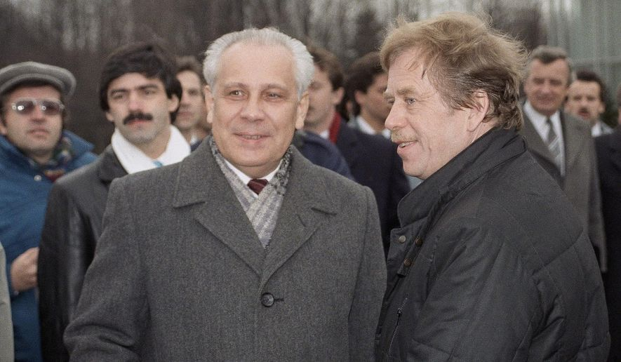 FILE - In this Wednesday, Feb. 28, 1990 file photo, Former Czechoslovak President Vaclav Havel, right, is met at airport by Russian Vice President Anatoly Lukyanov on arrival in Moscow. Anatoly Lukyanov, the speaker of the Soviet parliament who joined a hard-line coup that precipitated the Soviet collapse, has died at 88. Russia's Channel One state television said Lukyanov died Wednesday, Jan. 9, 2019. (AP Photo/Boris Yurchenko, File)