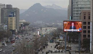 """A TV screen shows the live broadcast of South Korean President Moon Jae-in's press conference in Seoul, South Korea, Thursday, Jan. 10, 2019. Moon has suggested he'll push for sanction exemptions to restart dormant economic cooperation projects with North Korea. The slug reads: """"Basic pension expansion.""""(AP Photo/Ahn Young-joon)"""