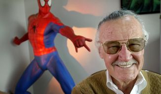 "This April 16, 2002 file photo shows Stan Lee, creator of comic-book franchises such as ""Spider-Man,"" ""The Incredible Hulk"" and ""X-Men,"" posing near a Spider-Man figure in his Santa Monica, Calif., office. Friends, fans and family of Stan Lee will gather in Hollywood on Jan. 30 for a memorial honoring the life and work of late Marvel Comics mogul. (AP Photo/Reed Saxon, File)"