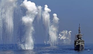 FILE - In this Sept. 17, 2014, file photo, Taiwan Navy's Perry-class frigate fires chaff during the annual Han Kuang military exercises off the east coast of Hualien, central Taiwan. Taiwan's military has announced a series of newly designed large-scale military drills for this year in response to China's continuing threat to use force to gain control over the island. (AP Photo/Wally Santana, File)