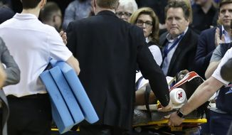 Oklahoma City Thunder forward Nerlens Noel is wheeled off the court on a stretcher in the second half of an NBA basketball game against the Minnesota Timberwolves in Oklahoma City, Tuesday, Jan. 8, 2019. (AP Photo/Sue Ogrocki)