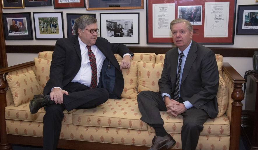President Donald Trump's then-attorney general nominee, William Barr, left, meets with Senate Judiciary Committee member and Trump confidant Sen. Lindsey Graham, R-S.C., on Capitol Hill in Washington, Wednesday, Jan. 9, 2019. (AP Photo/J. Scott Applewhite) ** FILE **