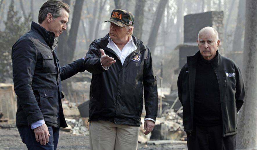 President Donald Trump talks with then Gov.-elect Gavin Newsom (left) as California Gov. Jerry Brown listens during a visit to a neighborhood impacted by the Camp wildfire in Paradise, Calif. (AP Photo/Evan Vucci, File)