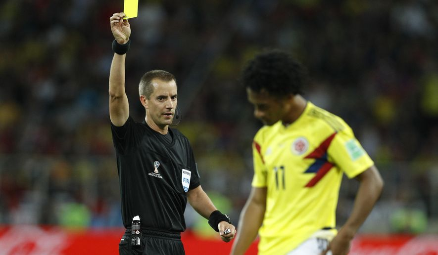 1c0124f7f ... referee Mark Geiger shows a yellow card to Colombia s Juan Cuadrado  during the round of 16 match between Colombia and England at the 2018 soccer  ...