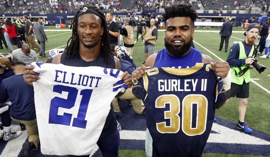 667002266 FILE - In this Oct. 1, 2017, file photo, Los Angeles Rams' Todd Gurley,  left, and Dallas Cowboys' Ezekiel Elliott, right, swap jerseys after an NFL  football ...