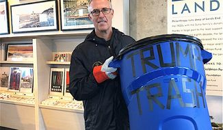 "Rep. Jared Huffman displays the ""Trump Trash"" he collected with Rep. Jackie Speier during the shutdown, then delivered to the White House. (Rep. Jared Huffman)"
