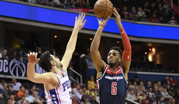 Washington Wizards forward Troy Brown Jr. (6) shoots against Philadelphia 76ers guard Furkan Korkmaz, left, during the second half of an NBA basketball game, Wednesday, Jan. 9, 2019, in Washington. The Wizards won 123-106. (AP Photo/Nick Wass) **FILE**